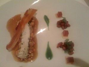 Fisch mit Specktranche und Granatapfel