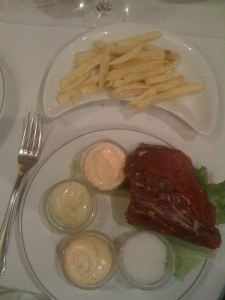 Beef with fries and sauces