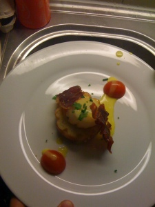 Coquilles St. Jacques served on a Brioche toast, accompanied with a Serranoham chip and drizzled with a light hollandaise